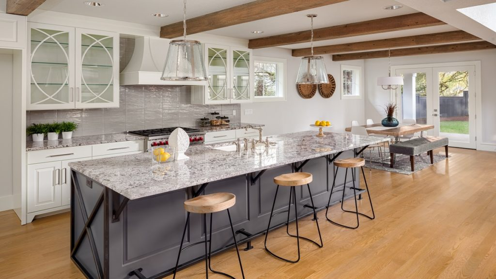 A large kitchen with stainless steel appliances  Description automatically generated